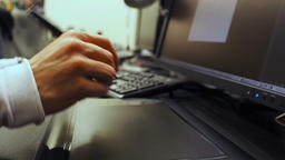 Keyboard 33. Close-up of male hands use graphic tablet and keyboard open and typ Footage
