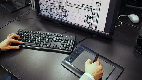 Tablet 38. Close up of the hand of a engineer editing scheme in CAD system, sign Footage