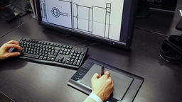 Tablet 49. Close up of the hand of a engineer editing scheme in CAD system, sign Footage