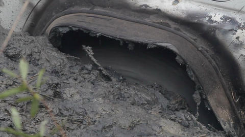 Close-up of a car wheel stuck in the mud Footage