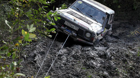 Car is trying to overcome the impassable section of the route with the help of a Footage