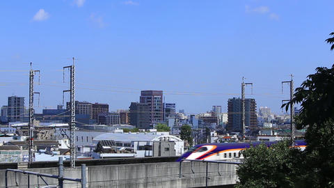 Shinkansen bullet train traveling on the elevated tracks of the city/高架線 Footage