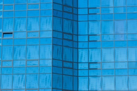 high building with glass facade fragment as background Photo