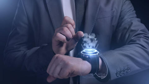 A man in a suit works with the smart watch of the future Animation