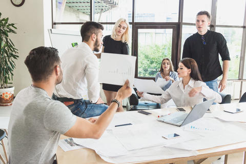 Stormy lively discussion of a project decision Each employee relies on their own Photo