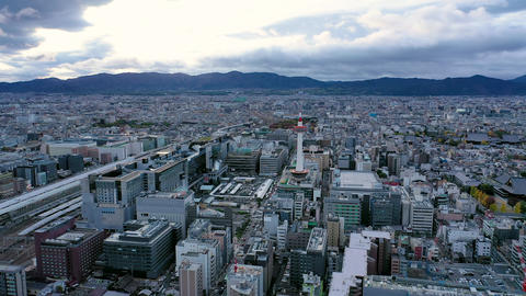 Aerial view 4k video by drone of Kyoto tower and buildings with skyline view in Kyoto city, Japan Live Action