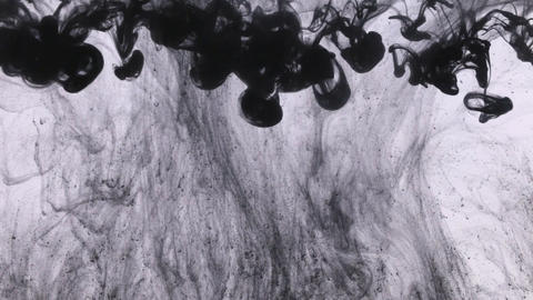 Droplet paint under water and move of black ink. Abstract swirls of black colors Live Action