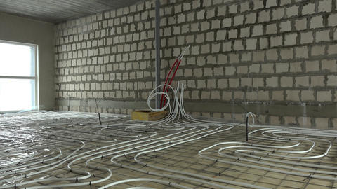 Heating pipes on construction area floor. Energy… Stock Video Footage