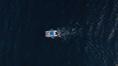 Top view on a big catamaran sailing in the Atlantic Ocean Live Action