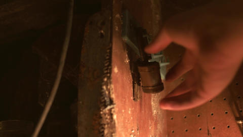 Old rusty padlock lit with lantern - Graded image Footage