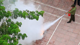 Close Petrol Burns in Vessel at Fire Brigade Exercises in Street Footage