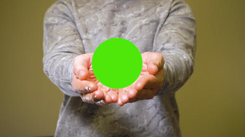 Man opens his palms and show green screen chromakey banner for advert or product Live Action