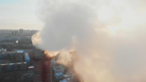 Air pollution problem in the city - a smoke from industrial pipe pollutes the Live Action