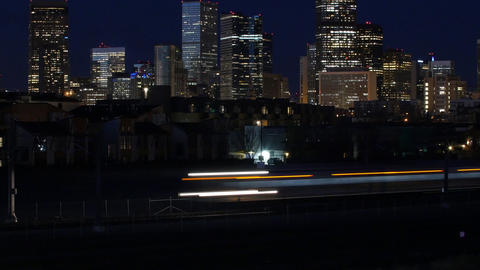 Cinemagraph of Commuter Trains Speed Past Cityscape Live Action
