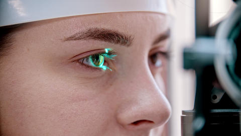 Ophthalmology treatment - a young woman checking her visual acuity - checking a Live Action