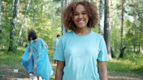 Slow motion portrait of African American lady eco-friendly person in forest Live Action