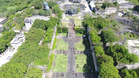 Aerial shot of the alley at the Cultural Park on Bali, tourists are walking, 4k Live Action