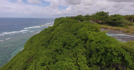 Aerial footage of the shoreline of the ocean, long wooden pier, Bali, 4k Live Action