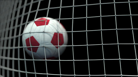 Ball with flags of Morocco in goal against black background. Conceptual 3D Live Action