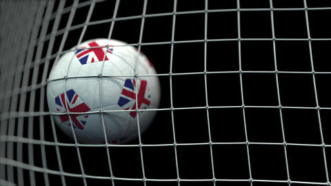 Ball with flags of Great Britain hits goal. 3D animation Live Action