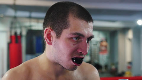 Box training - a man with mouth guard getting hit - the guard flies out of mouth Live Action