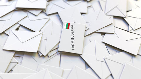 Letter with From Bulgaria text on pile of other Letters. International mail Live Action