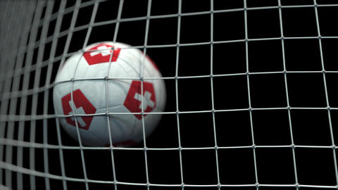 Ball with flags of Switzerland in goal against black background. Conceptual 3D Live Action