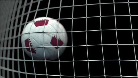 Ball with flags of Qatar in goal against black background. Conceptual 3D Live Action