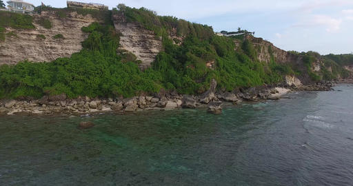 Gorgeous view on the cliffs with trees on them, shoreline of Bali, aerial shot Live Action