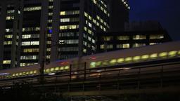 Shinkansen bullet train traveling on the Tokyo office near the city/東京、都 ビデオ