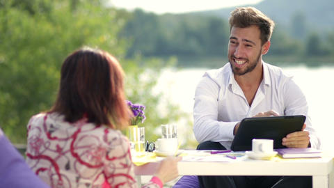 Businessman discussing with partner growth of sale Live Action