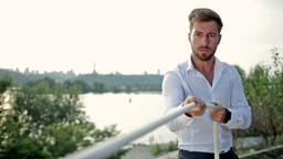 Young businessman pulling a rope outdoors Footage