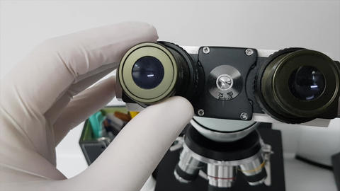 Operating a microscope in the microbiology laboratory Live Action