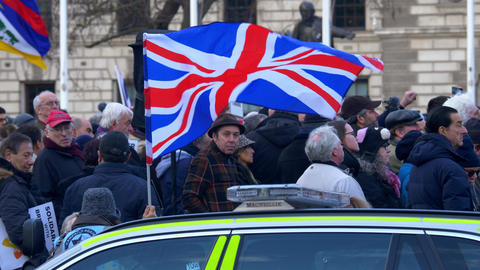 United Kingdom flag political rally - LONDON, ENGLAND - DECEMBER 10, 2019 Live Action