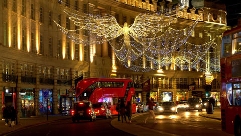 Street traffic on Regent Street London at Christmas time - LONDON, ENGLAND - Live Action