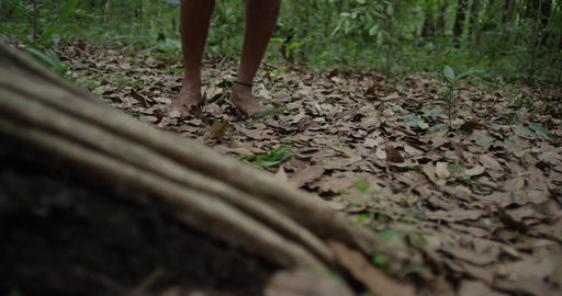 The man walks barefoot with a mountain in the woods Live Action
