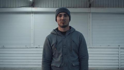 The economic crisis has closed the shop of a young man. Economic crisis concept Live Action