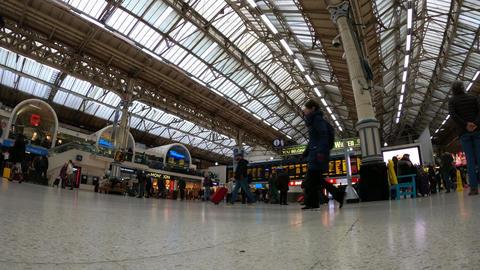 Travellers at a railway station - timelapse shot - LONDON, ENGLAND - DECEMBER 10 Live Action