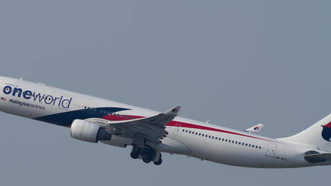 Malaysia Airlines Airbus A330 departure from Hong Kong Live Action