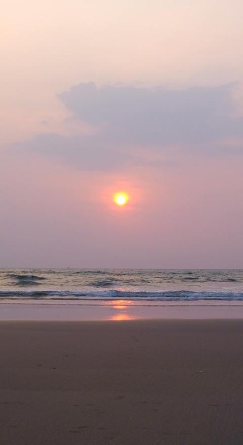 Vertical Background Sunset on sandy beach GIF