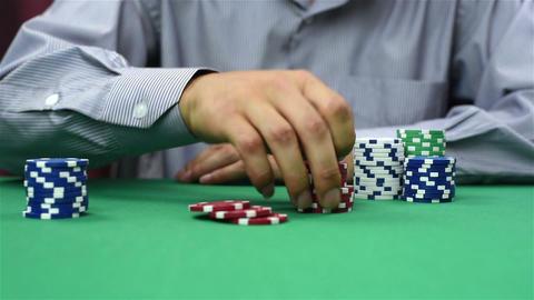 dealer recounts poker chips Live Action