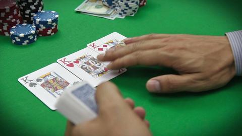 poker dealer distributes cards Footage