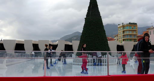 Children Having Fun On An Outdoor Skating Rink In The Christmas Market Of Menton Live Action