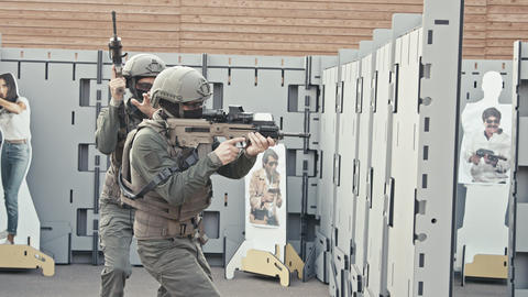 Slow motion of soldiers training in close quarters combat Live Action