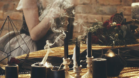 Woman with candles divination magic Live Action