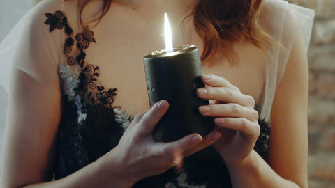 Witch guessing with candle Live Action