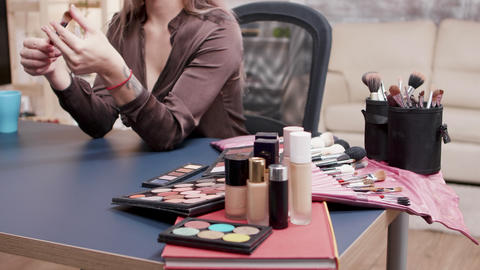 Beautiful beauty vlogger recording a vlog about makeup brush Live Action