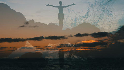 Silhouette of a woman raising arms in front of the ocean at sunset. Girl Live Action