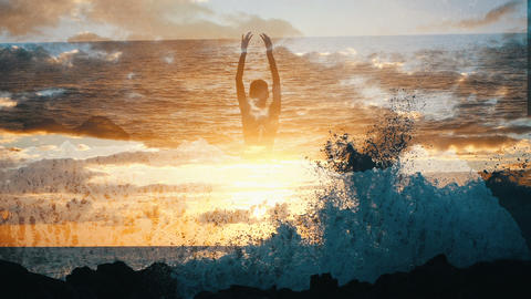 Silhouette of a woman in the sky over ocean raising arms in at sunset. Girl Live Action