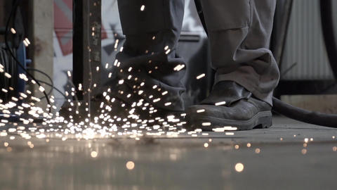 sparks falling to ground and explode in slowmotion Live Action